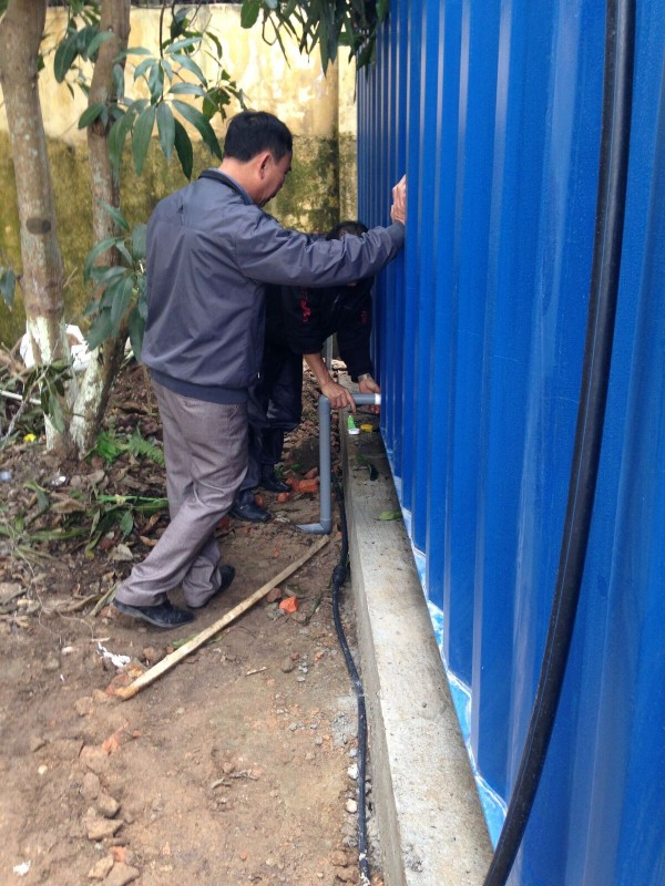 Connecting the container to the water pipes which have been prepared in advance